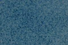 Blue Mottled Paper Background. Mottled backlit paper in tones of blue Stock Image