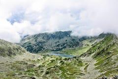 Blue mountain lake. Bucura lake is a glacial lake in Retezat mountains,Romania Royalty Free Stock Images