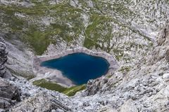 Blue mountain lake from above stock photography