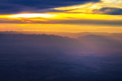 Blue mountain with orange sky while rising sun Stock Images