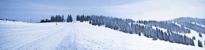 Blue mountain panorama. A beautiful panoramic shot from a snowy mountain top Stock Photography