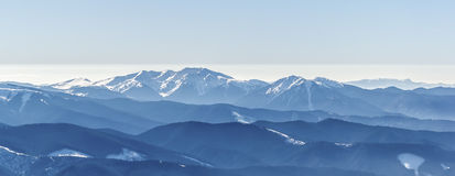 Blue mountain peaks. Distant sharp peaks. blue mountain ranges. Ukrainian Carpathian Mountains Stock Photography