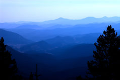 Blue mountain rockies. The Rocky Mountains shot with blue hazy filter stock photo
