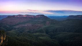 Blue Mountain`s distinctive blue haze in the morning at Ecco Poi. The vast expanse of eucalyptus rainforest and sandstone cliffs at Ecco Point in Blue Mountains Royalty Free Stock Photos