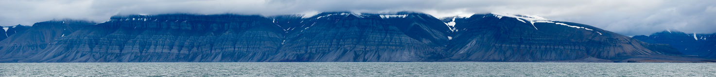 Blue Mountains. A blue mountain panorama over Isfjorden in Svalbard. Spitsbergen, Norway royalty free stock photos