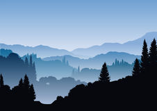 Blue mountains. Beautiful misty landscape with mountains and trees Stock Image