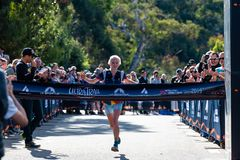 Ultra-Trail Australia UTA11 race. Runner Paige Penrose, winner of the womens event, at the finish line, about to cross stock photography
