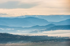 Blue mountains covered with mist Royalty Free Stock Image