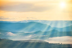 Blue mountains covered with mist Stock Photo