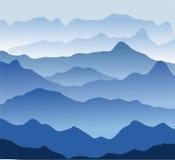 Blue mountains in a fog Stock Photos