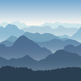 Blue mountains in the fog. Seamless background. Stock Photography