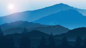 Blue mountains landscape in the fog. Stock Photos