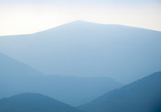 Blue mountains layers during sunset Stock Image