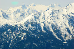 Blue mountains and snow capped peaks Stock Photo