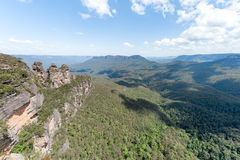 Blue Mountains in Sydney, Australia. Cloudy Blue Sky and Shadows. Three Sisters on Left. Wide Angle Stock Photo
