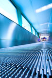 Blue moving escalator in the office hall Royalty Free Stock Images