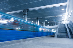 Blue moving train Stock Image