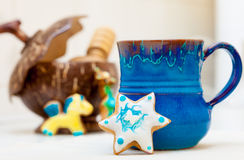 Blue mug and christmas gingerbread cake star icing decoration Royalty Free Stock Photos