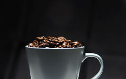 Blue Mug filled with Coffee Beans Royalty Free Stock Images