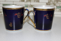 Blue mug. S for tea with the image of berries Royalty Free Stock Photos