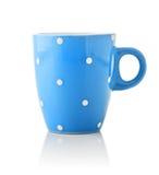 Blue mug with polka dot pattern. Blue mug in polka dot on white background Royalty Free Stock Photo