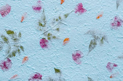 Blue mulberry paper with petal and leaf texture background. Stock Photos