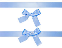 Blue multiple ribbons with bow, isolated Royalty Free Stock Photo