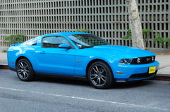 Blue Mustang. A classic blue Ford Mustang parked on the street Stock Photography