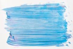 Blue nail polish smears on white background Royalty Free Stock Image