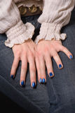 Blue nails. A pair of hamds with a painted in blue nails Stock Image