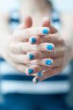 Blue nails detail Royalty Free Stock Photo