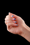 Blue nails on tips. On black background Royalty Free Stock Photography
