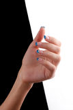 Blue nails on tips. On black and white background Royalty Free Stock Photos