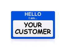 Your Customer. A blue name tag with the text 'Hello I am... Your Customer Stock Photo