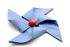 Blue napkin with ladybird Stock Photos