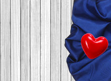 Blue napkin and red heart on wooden table Royalty Free Stock Photography