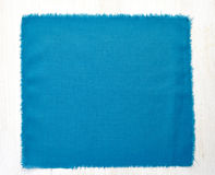 Blue napkin on white wooden table Stock Photo