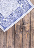 Blue napkin on wooden table Royalty Free Stock Image