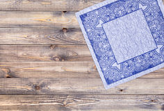 Blue napkin on wooden table, top view Royalty Free Stock Photos