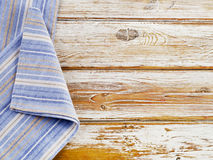 Blue napkin on a wooden table Royalty Free Stock Photography
