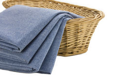 Blue Napkins in a Wicker Basket Stock Images