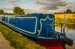 Blue Narrow Boat - Midlands, the heart of England. Narrowboat moored on a stretch of the Grand Union Canal by the town of Radford Semele near Leamington Spa royalty free stock photos