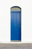 Blue narrow timber door on the white background Stock Photography