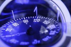 Blue nautical compass closeup focus on east Royalty Free Stock Photos