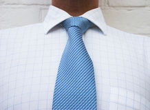Blue neck tie. Neck tie & check shirt Stock Image
