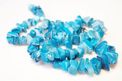 Blue necklace 01. Blue necklace on white background stock images