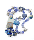 Blue necklace with agate. On white background Royalty Free Stock Photo