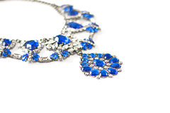 Blue necklace. Beautiful blue necklace in teardrop shape on white background Stock Photos