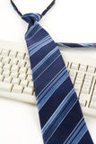 Blue Necktie and Keyboard Royalty Free Stock Image