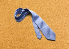 Blue necktie on sand Royalty Free Stock Photos